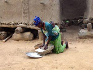 Woman grinding flour